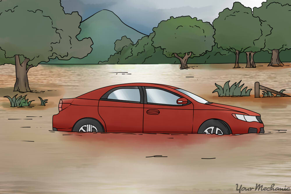 red car sitting in flood water