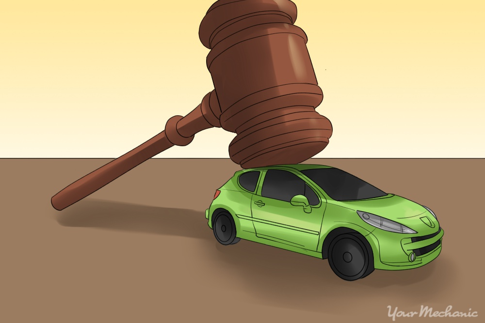 gavel sitting on top of green car