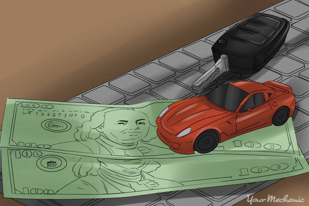 toy car and money on top of keyboard