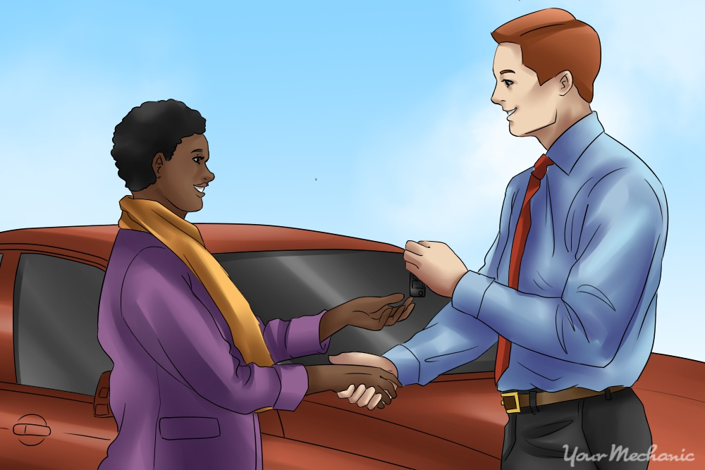 car dealer and buyer shaking hands