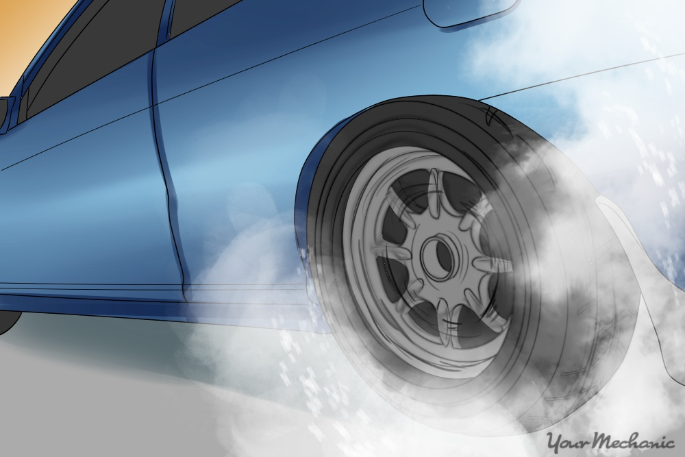 car wheel performing a burnout