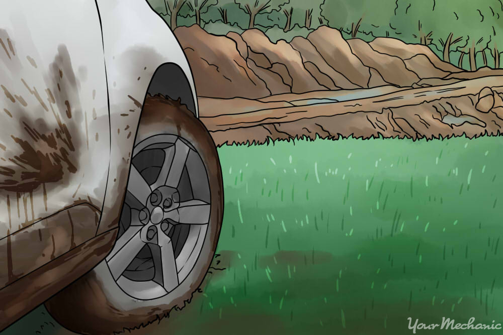 white car full of mud driving in field