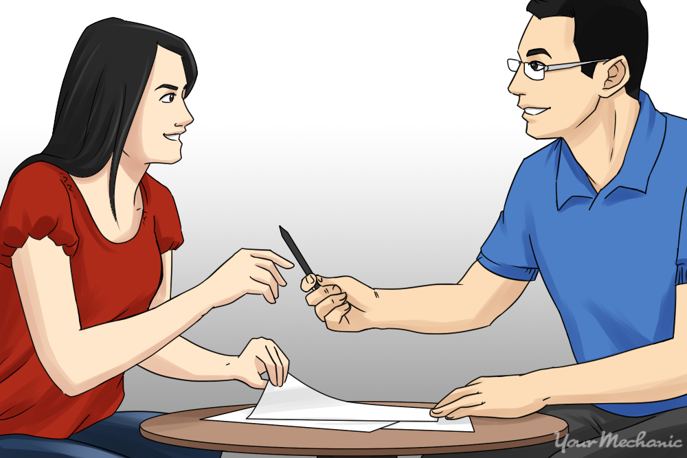 two people signing for a car loan