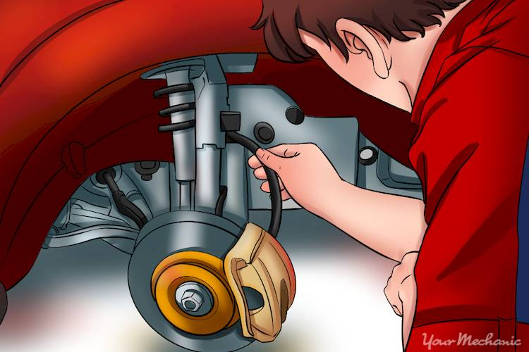 person inspecting brake line