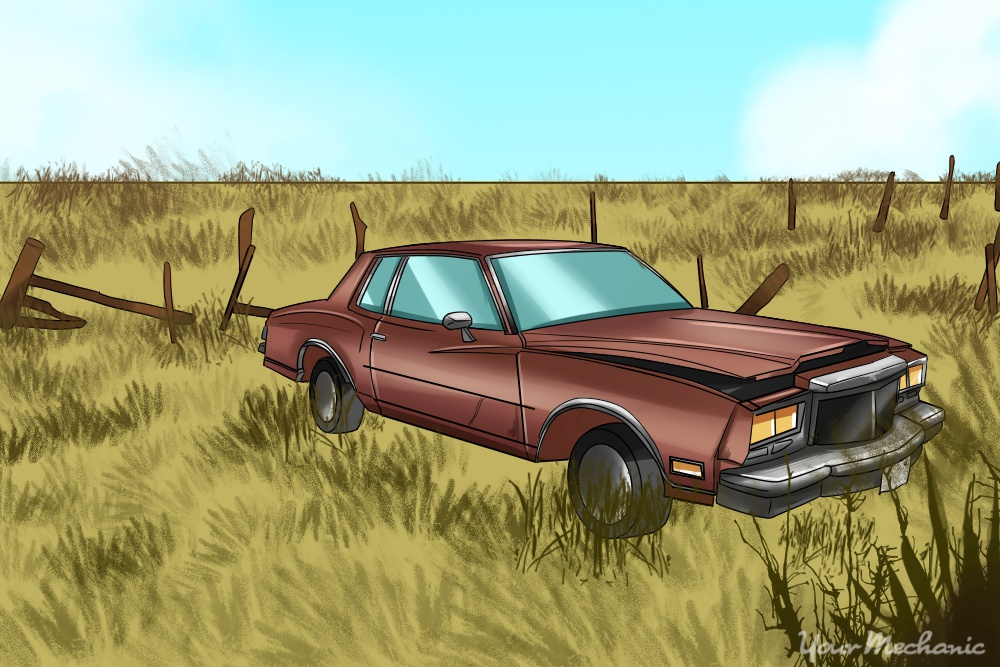 abandoned car in middle of field