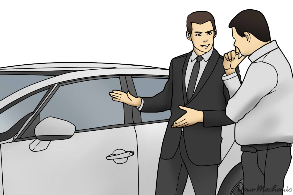 man standing next to car salesman