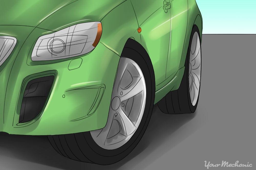 front end of green car with wheel turned