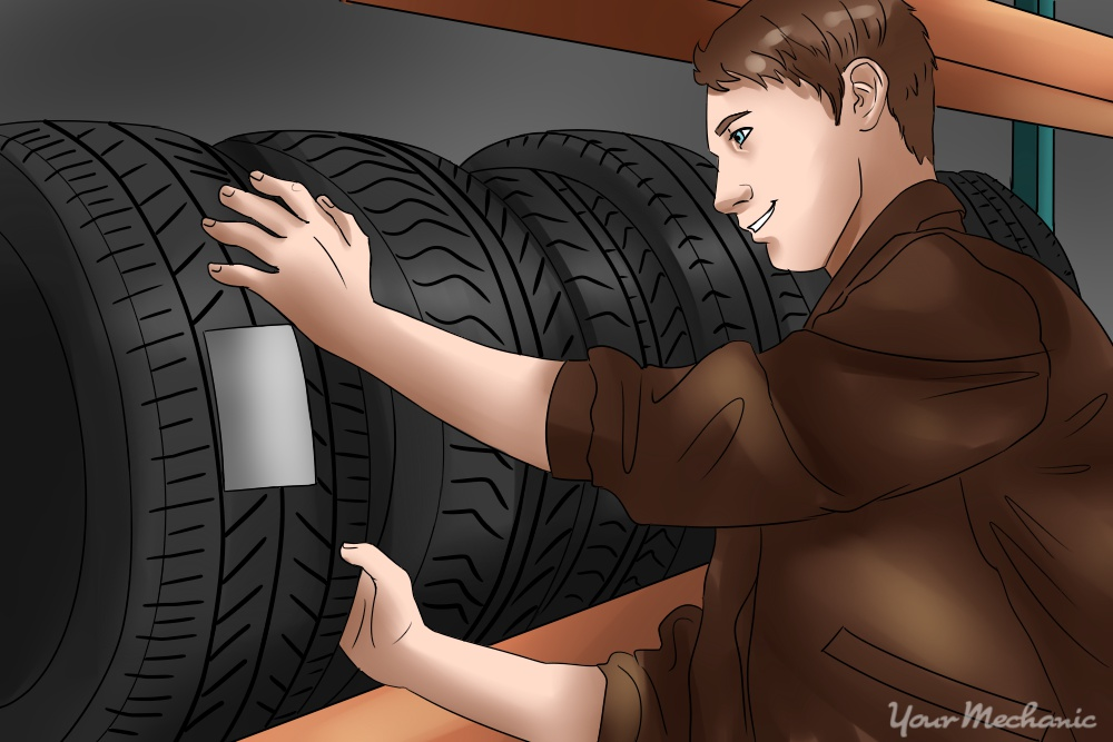 person inspecting tires