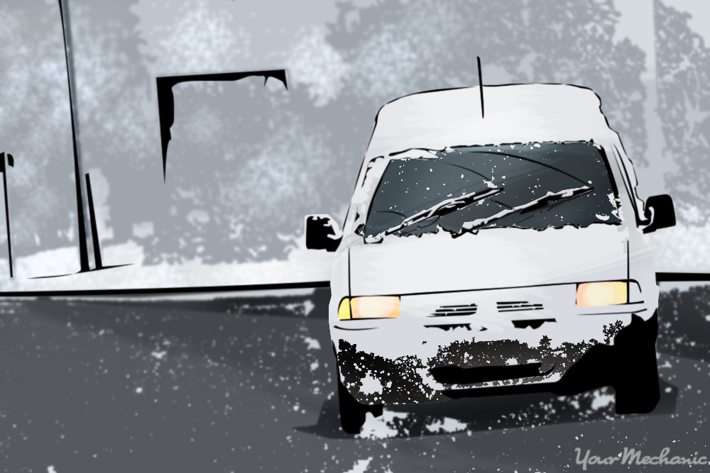 van driving on snowy road