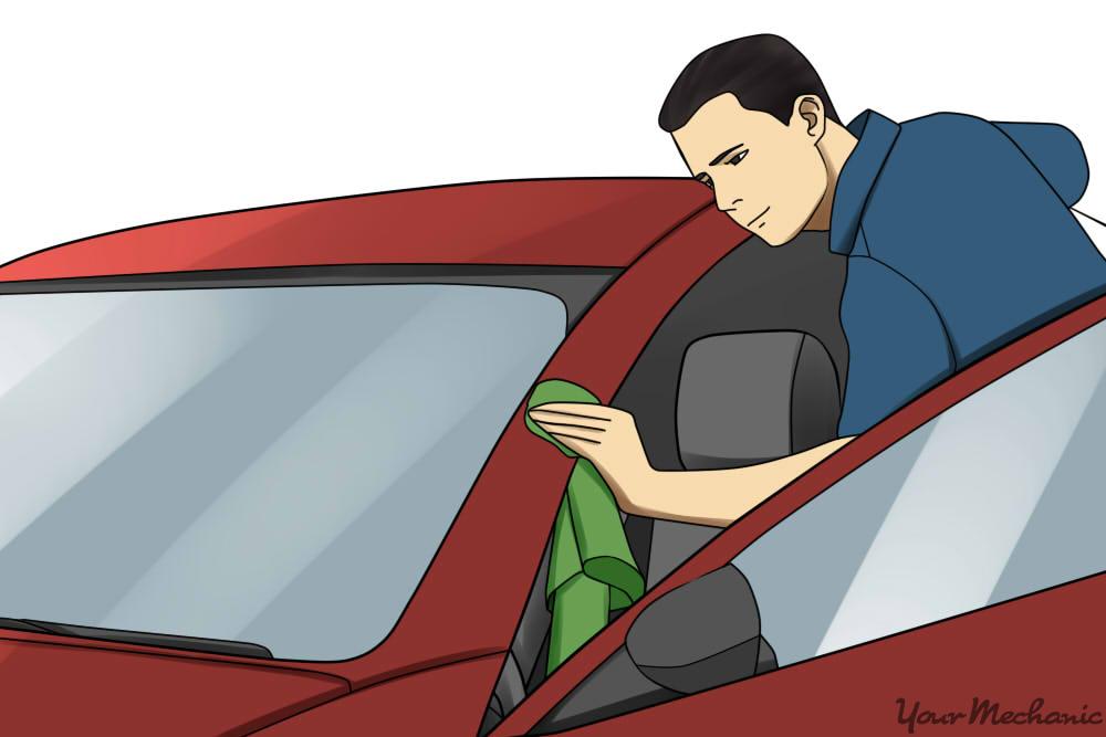 man polishing the car paint