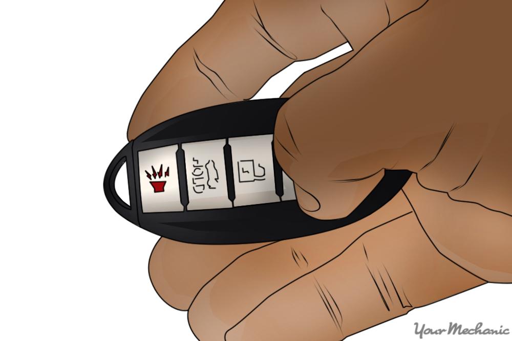 hand holding key fob