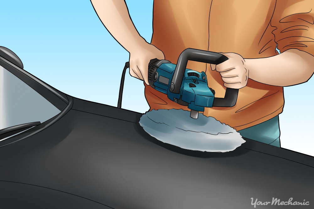 How to Properly Buff Clear Coat - person buffing car hood