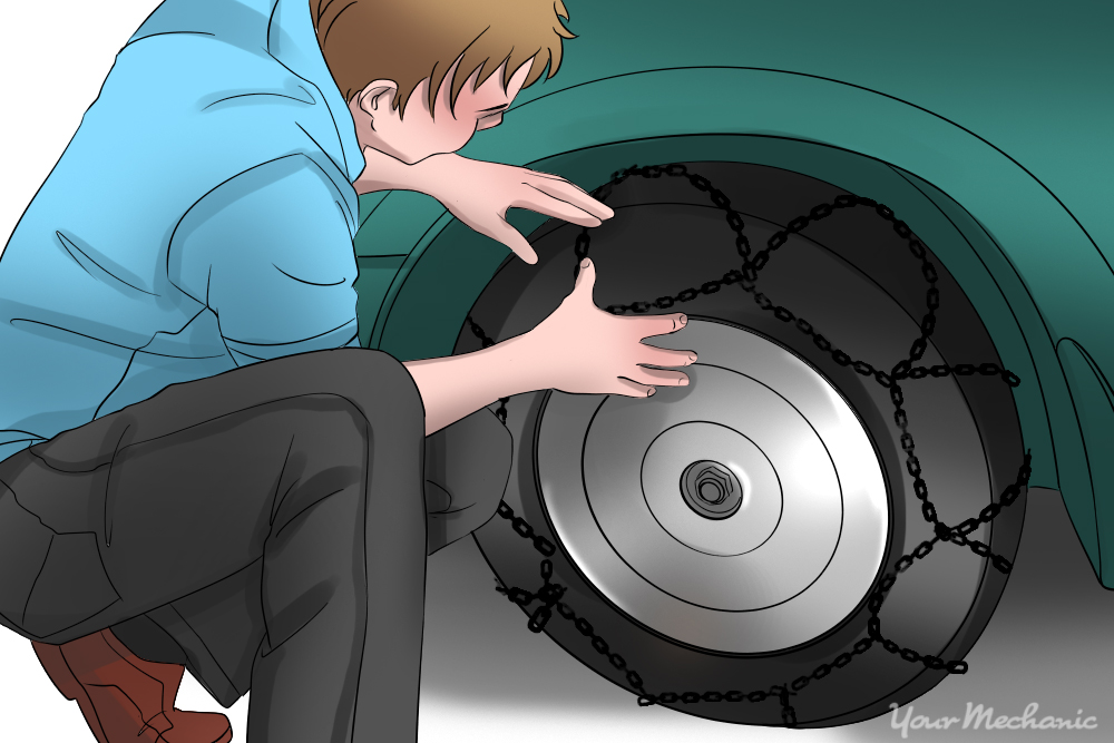 person installing front wheel chains to tire