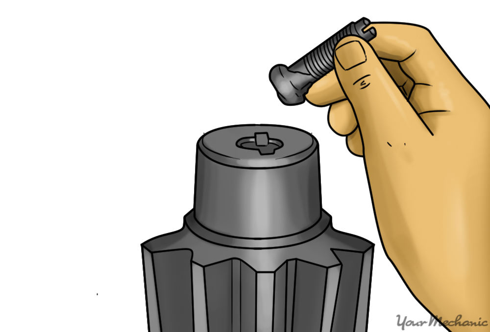 steering gear adjuster plug is the screw in the hand of the attached
