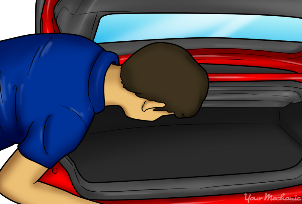 person searching the trunk of their car