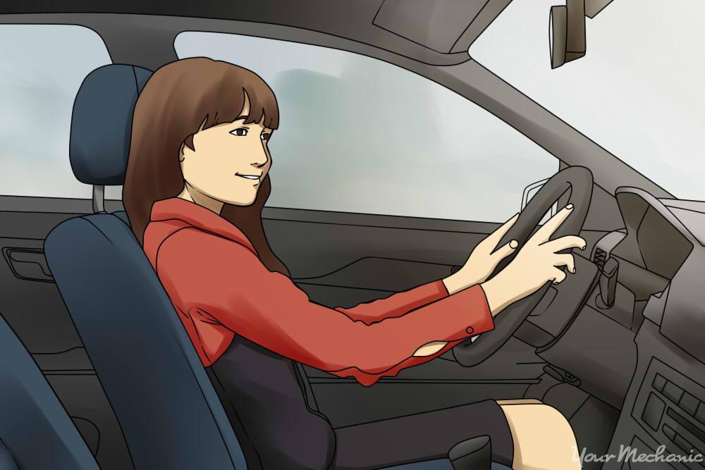 girl sitting in drivers seat