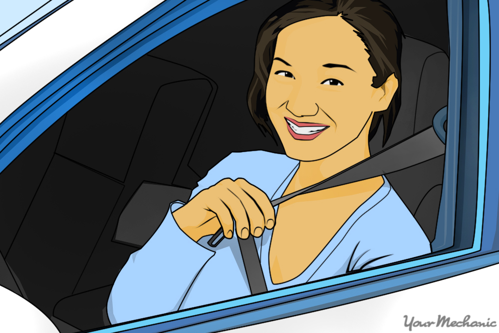smiling girl fastening her seatbelt