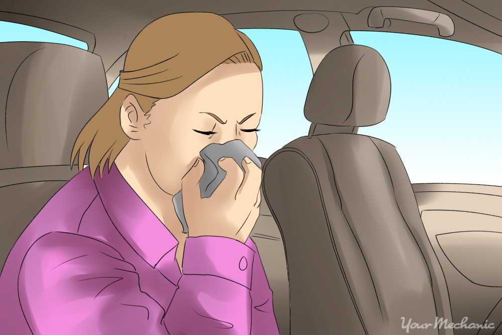girl covering mouth and nose with rag because of smell