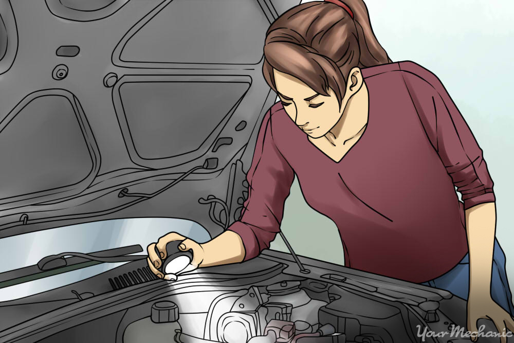 woman inspecting engine