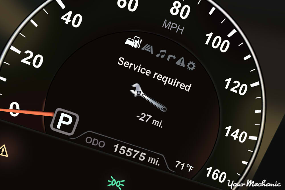 Understanding Kia Service Indicator Lights - Kia instrument display with Service Required message on