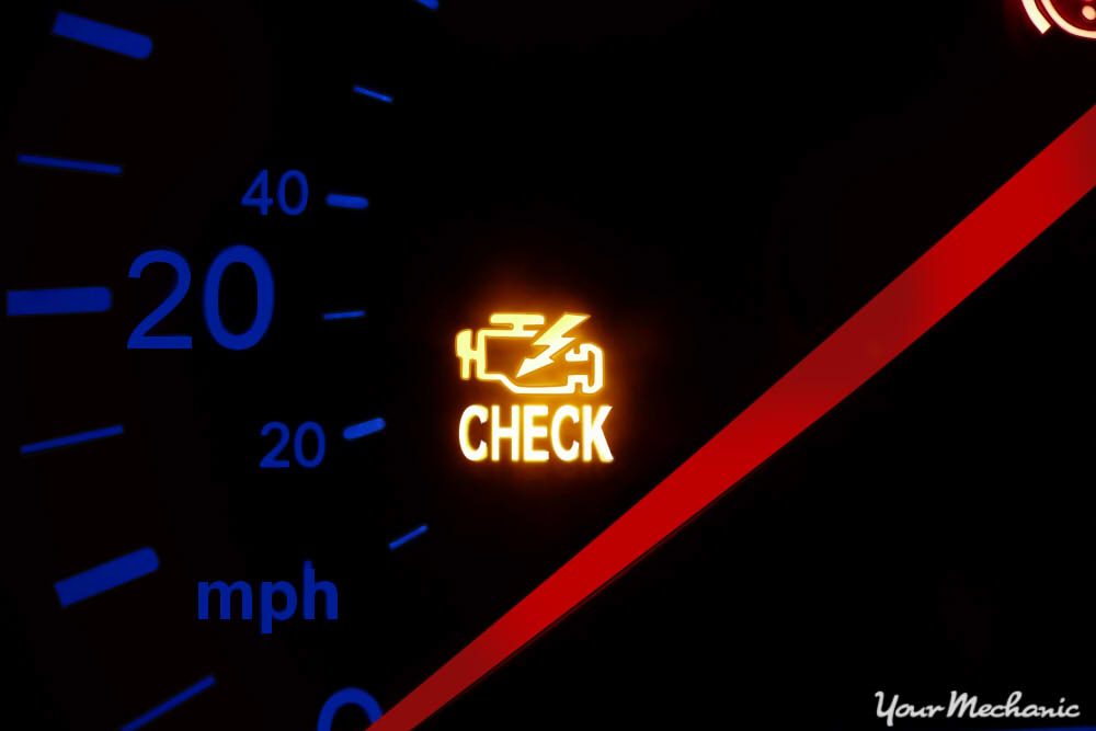 Understanding Mazda Service Indicator Lights - instrument display on a Mazda showing Check Engine light on