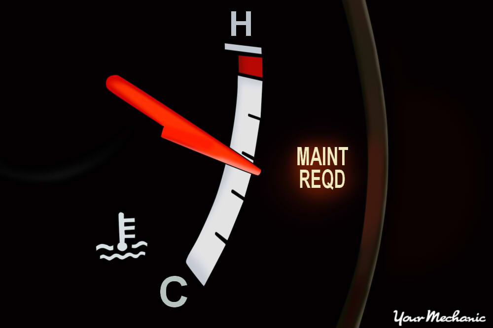 Understanding Toyota Service Indicator Lights - instrument display of a Toyota with Maintenance Required light on