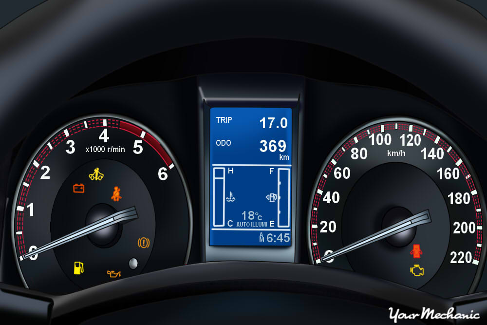 understanding isuzu service indicator lights - view of an isuzu instrument  panel with warning light on