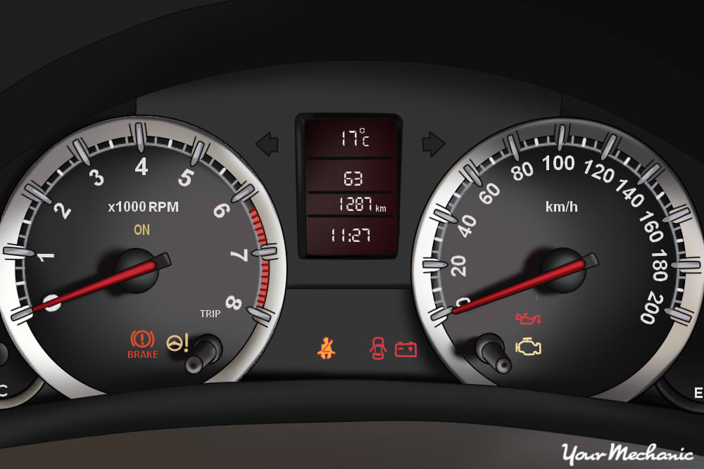Understanding Suzuki Service Indicator Lights - view of a Suzuki instrument panel with warning light on