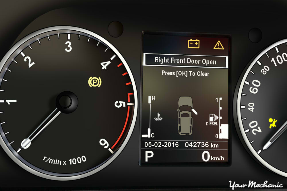 Understanding Land Rover Service Indicator Lights - view of a Land Rover instrument panel with warning light on
