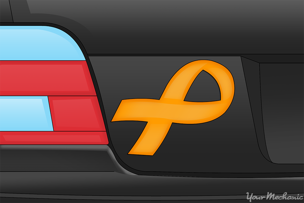 yellow ribbon stuck onto back of car