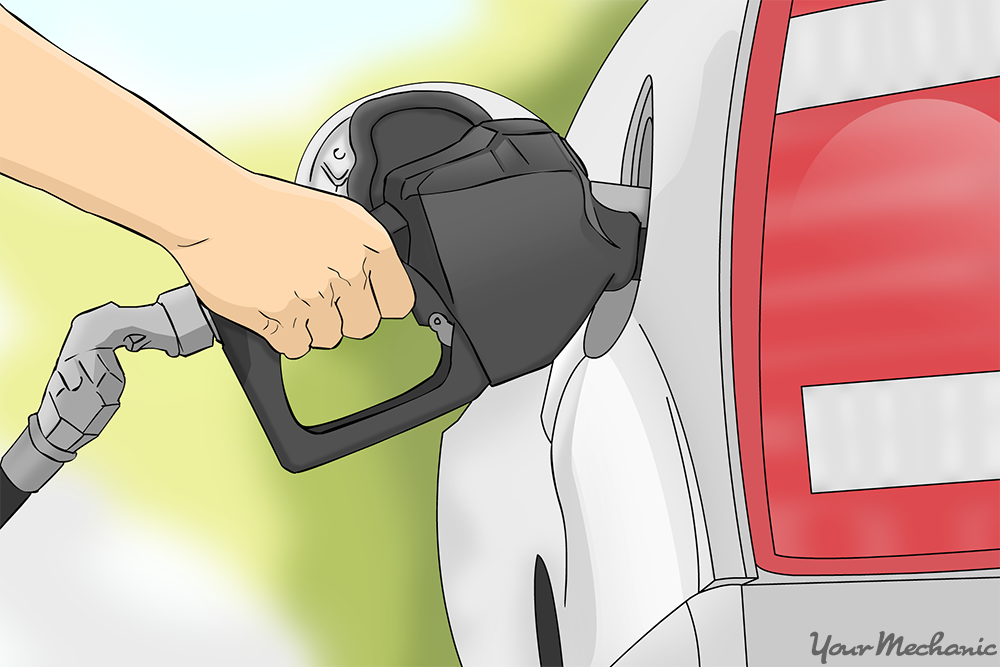 person holding gas pump in gas tank of car