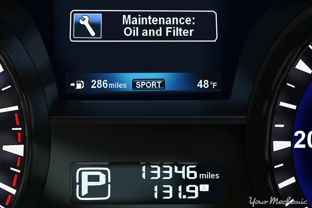 Understanding Infiniti Service Indicator Lights - instrument display of an Infiniti with the oil and filter maintenance light on