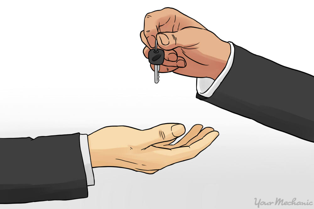 person handing over keys o someone else