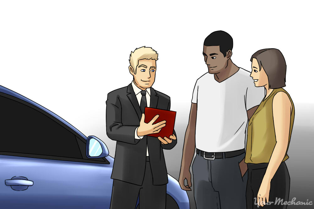dealer talking to people next to car
