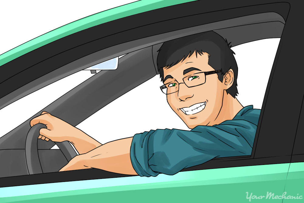 guy smiling looking out of car