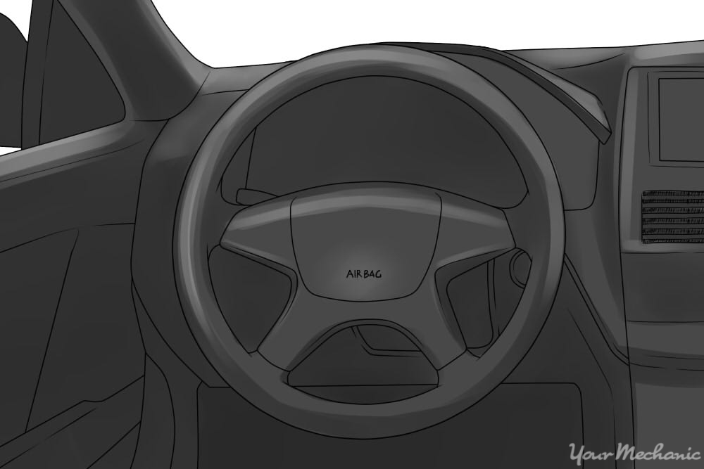 "close up of steering wheel with the words ""air bag"" on it"