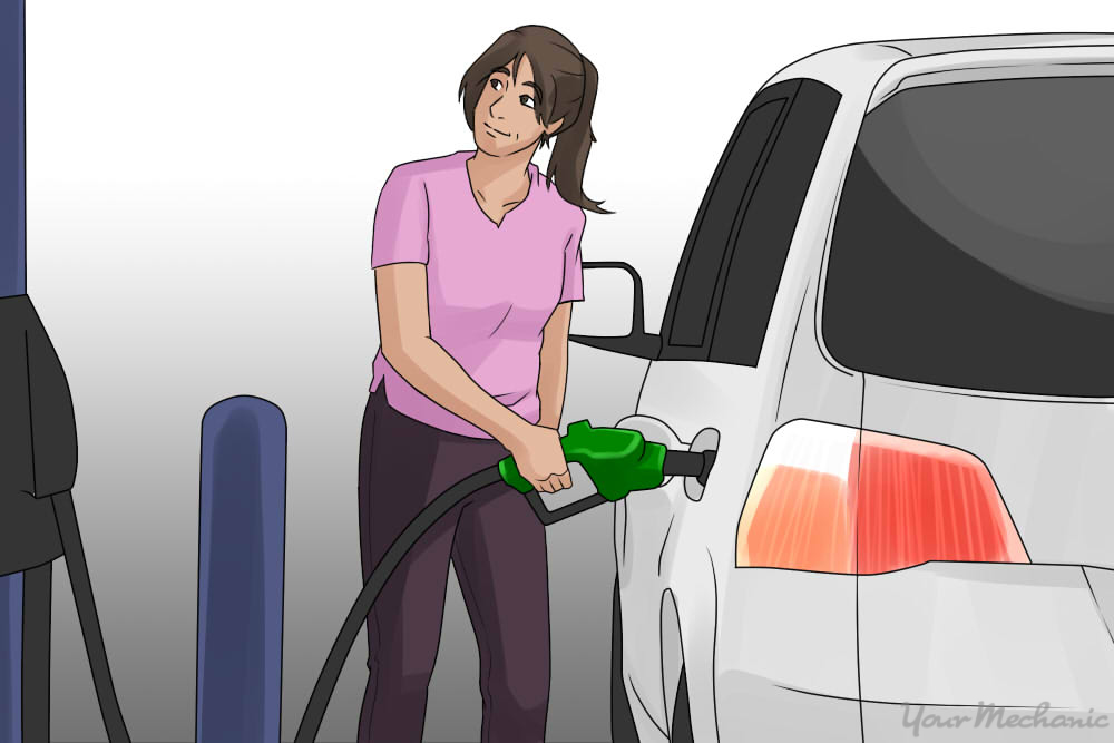 girl pumping in gas