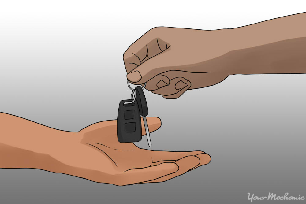 person handing over keys