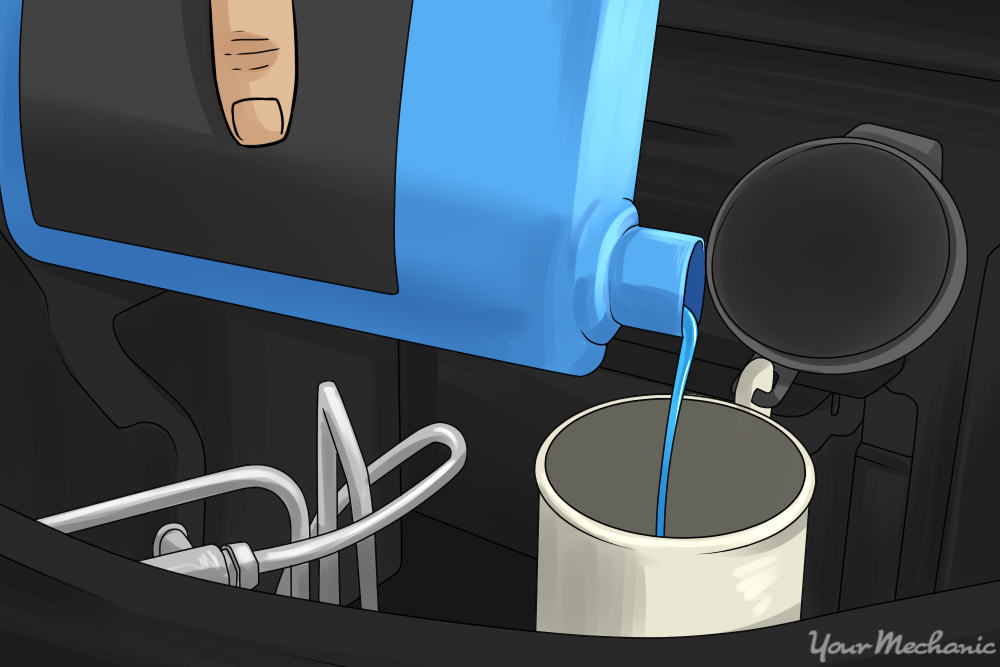 person filling up fluid reservoir