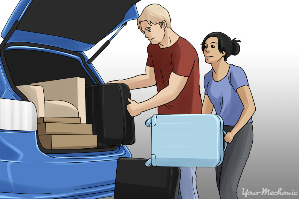 couple packing belongings into car