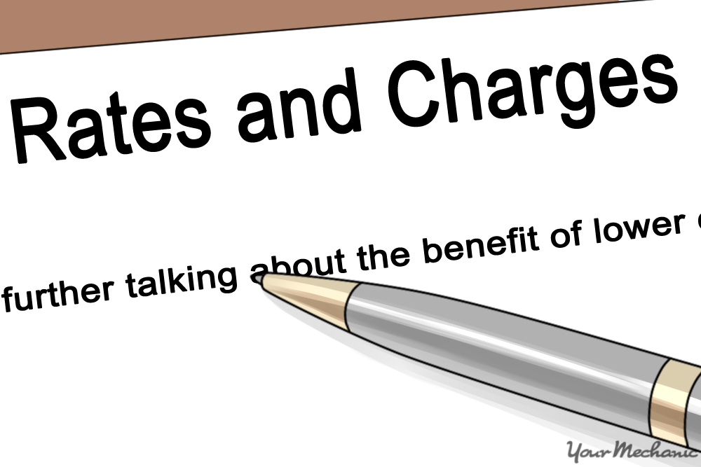 pen ontop of piece o paper labeled rates and charges