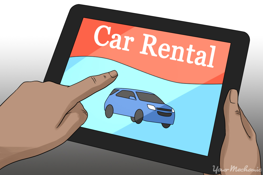 tablet in hand showing car rental