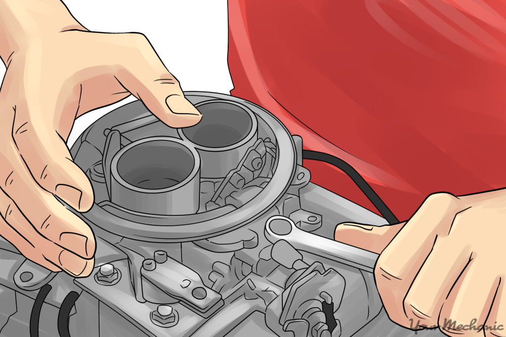 person tightening a carburetor