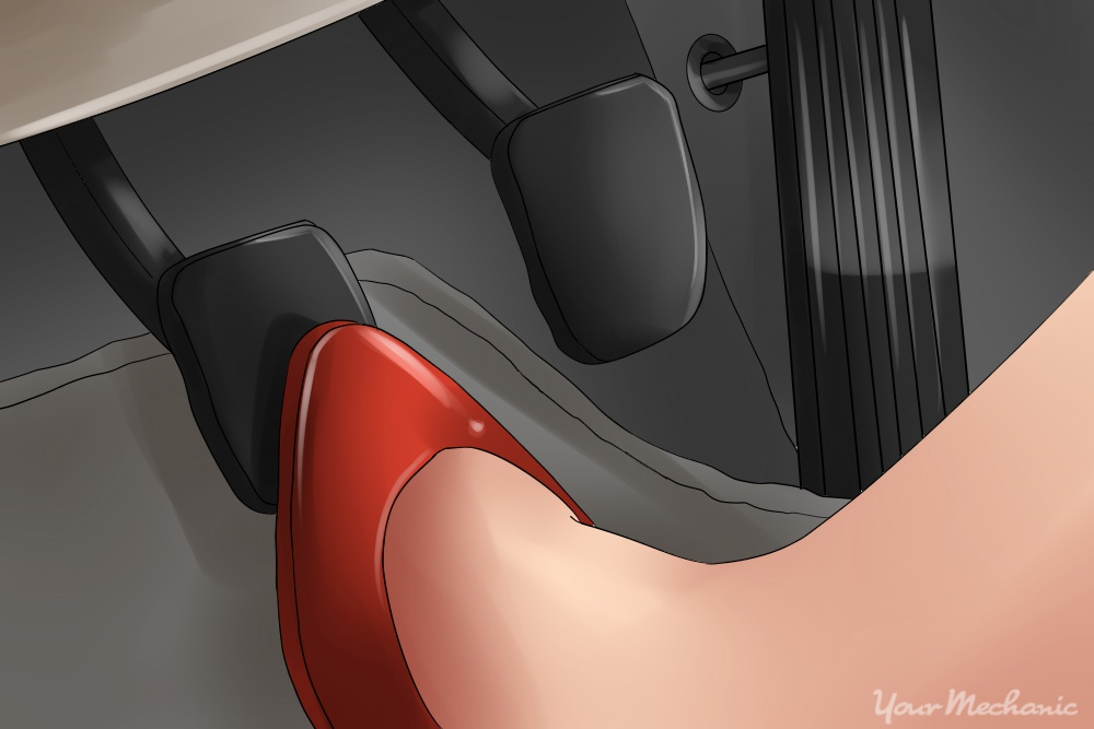 picture of foot depressing the clutch pedal