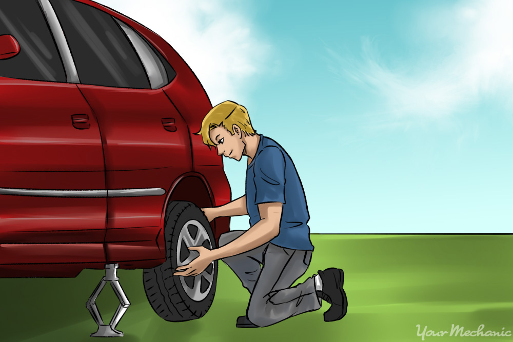 lifting spare tire onto wheel hub