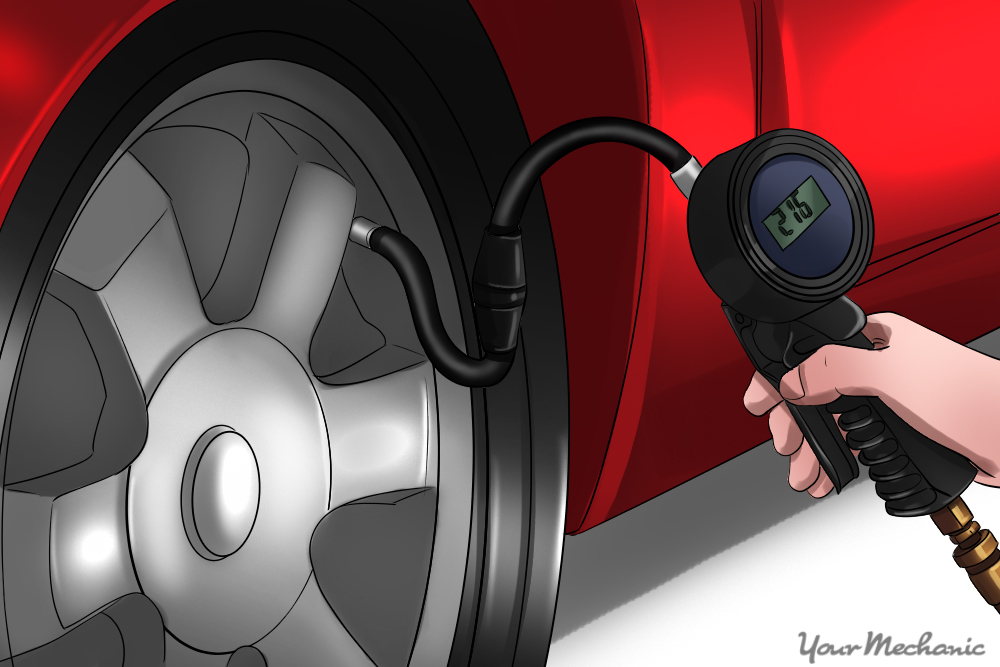 person using a tire pressure gauge