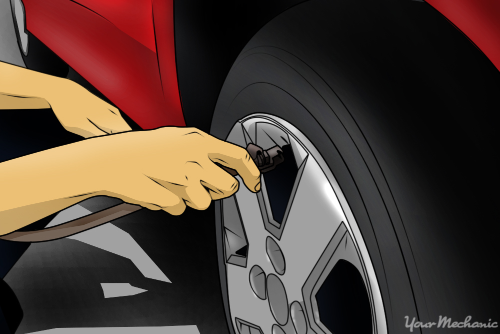 person inflating tires