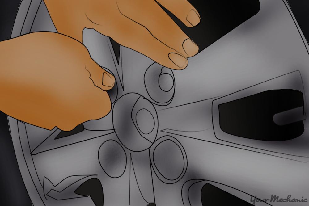 hands tightening lug nuts
