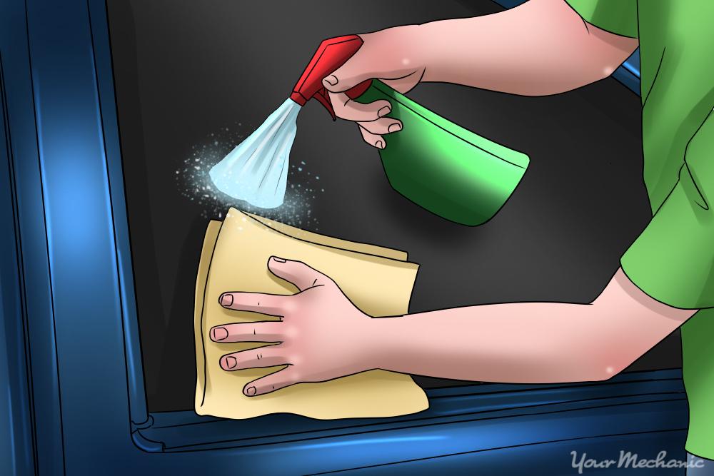 applying glass cleaner