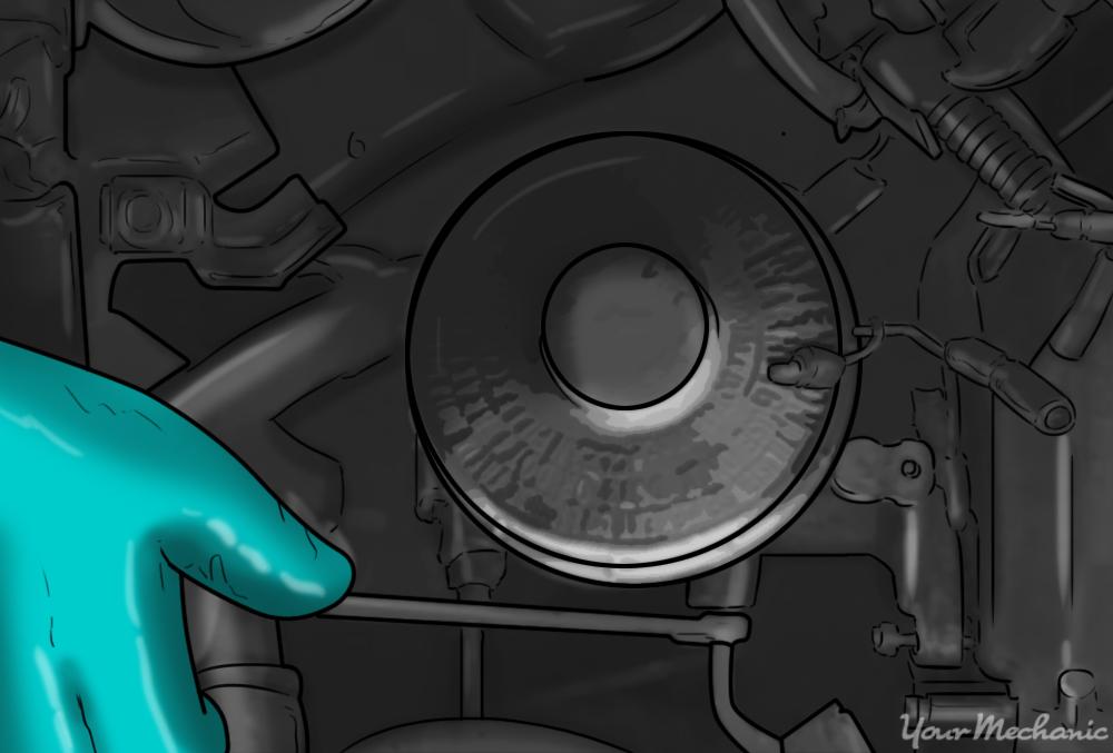 hand removing brake lines